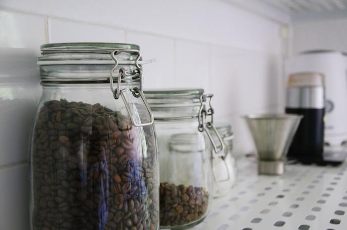 Coffee beans in sealed jars.