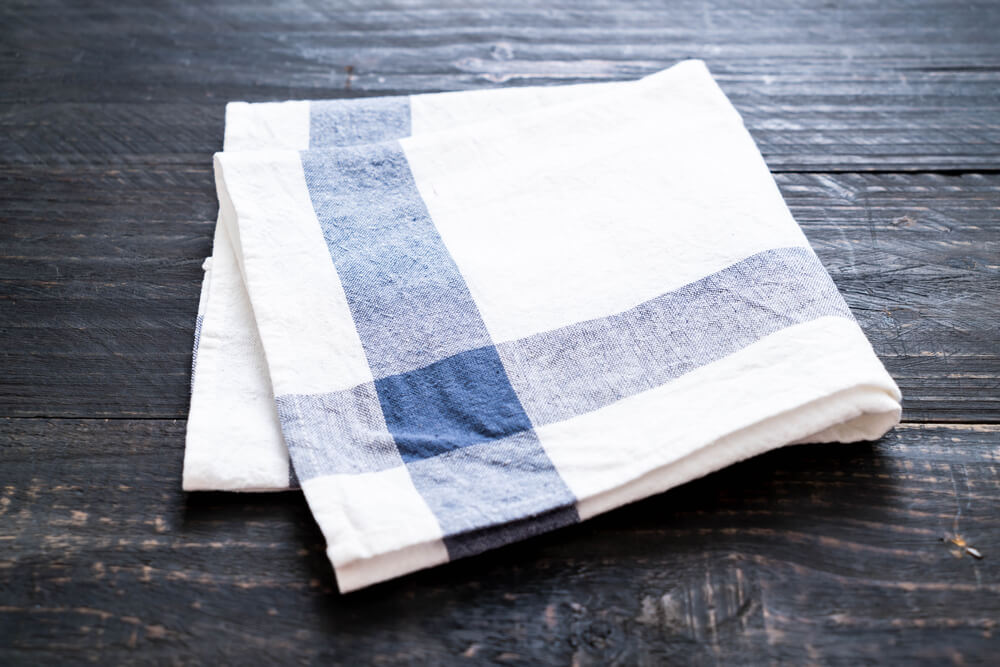 kitchen napkin laid on top of a table