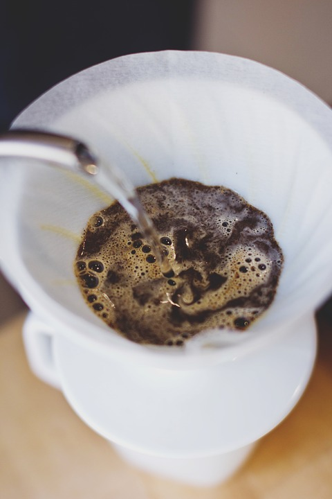 Coffee being poured into a cup.
