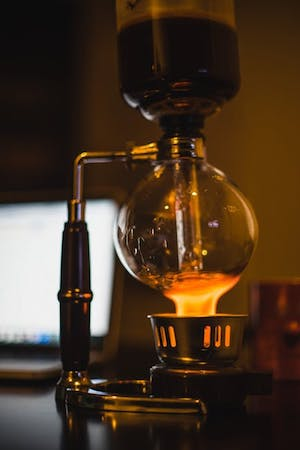 Coffee being brewed with a siphon.