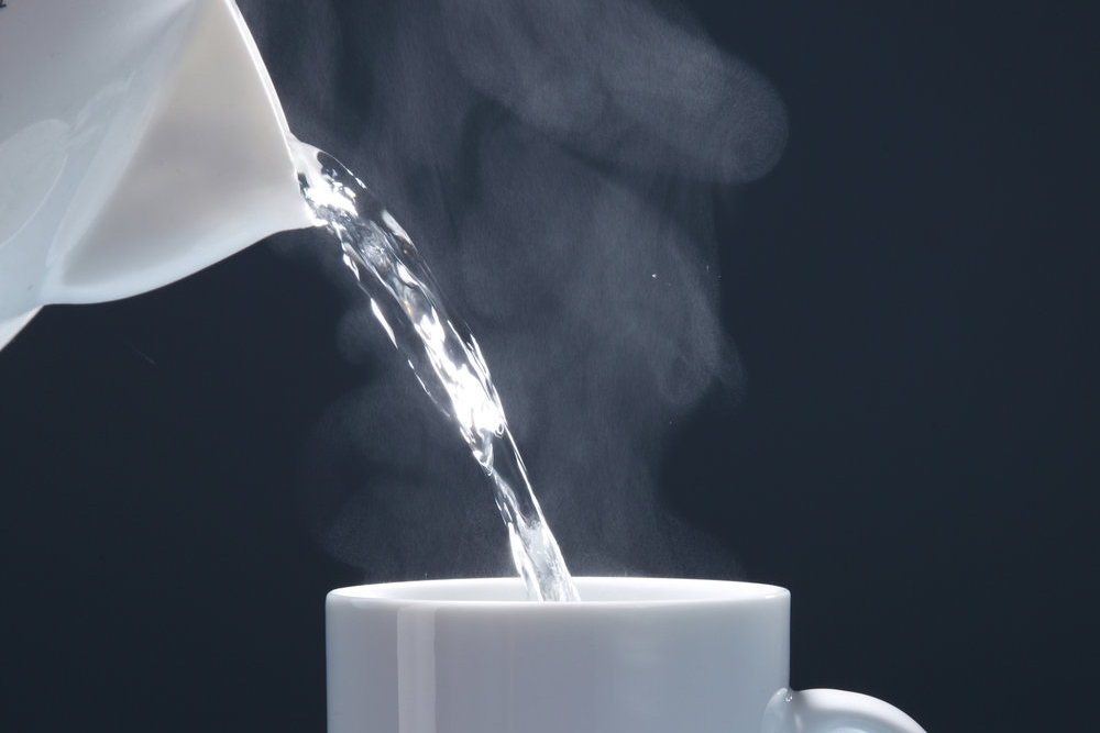 pouring hot drink to the mug