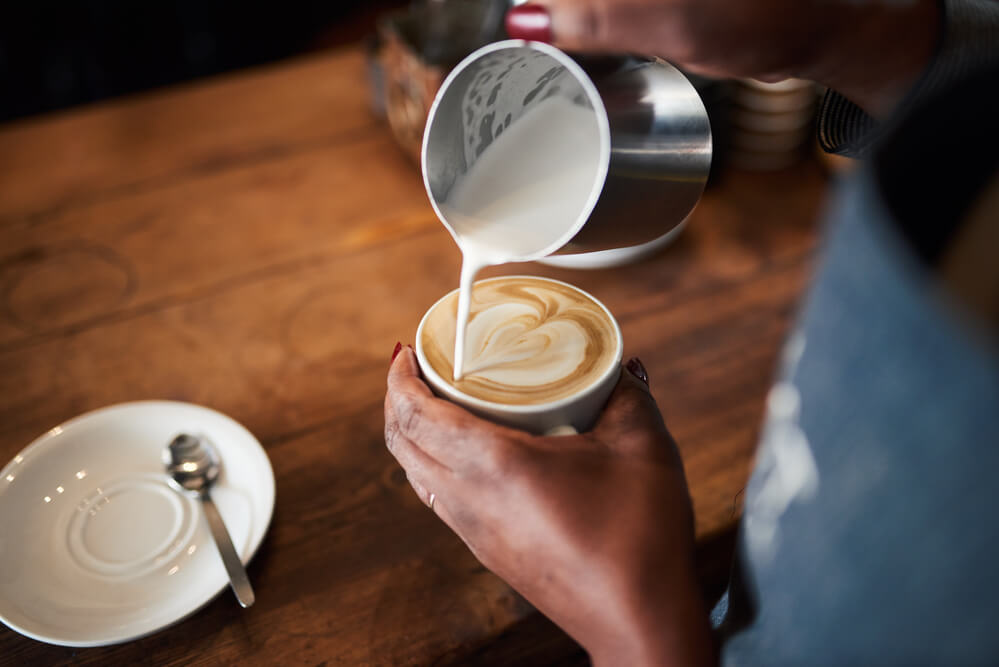 different ways to make coffee - making a heart shape with a frothed milk