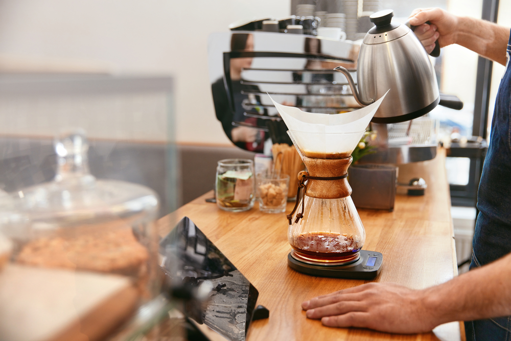 Pour over coffee makers - barista preparing fresh coffee
