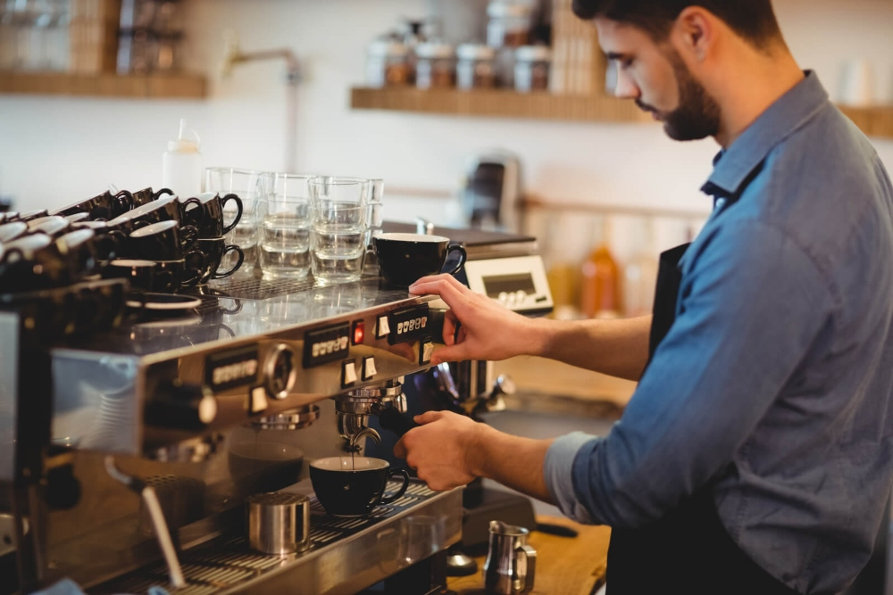 why are espresso machines so expensive - man making a coffee espresso using an espresso machine