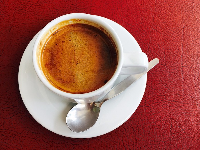 A cup of Espresso coffee on a table.