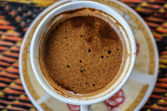A close up of black coffee in a cup.