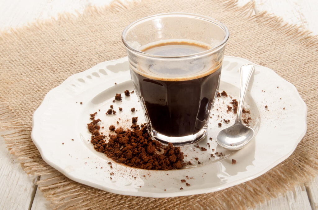 A glass of instant coffee on a plate