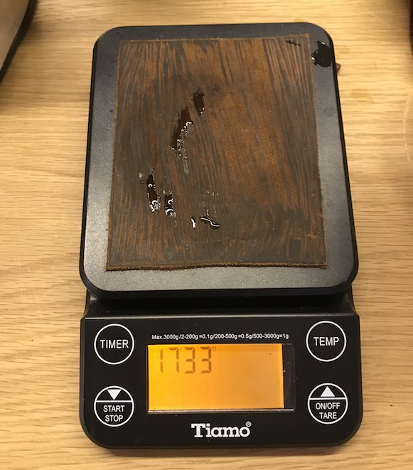 Electric scales on a table for weighing coffee.