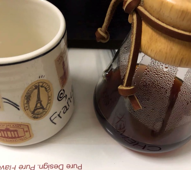 A close up of a coffee cup, with Chemex and Coffee Filter - use regular coffee filters in a chemex