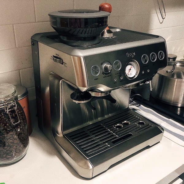 A stove top coffee machine sitting inside of a kitchen