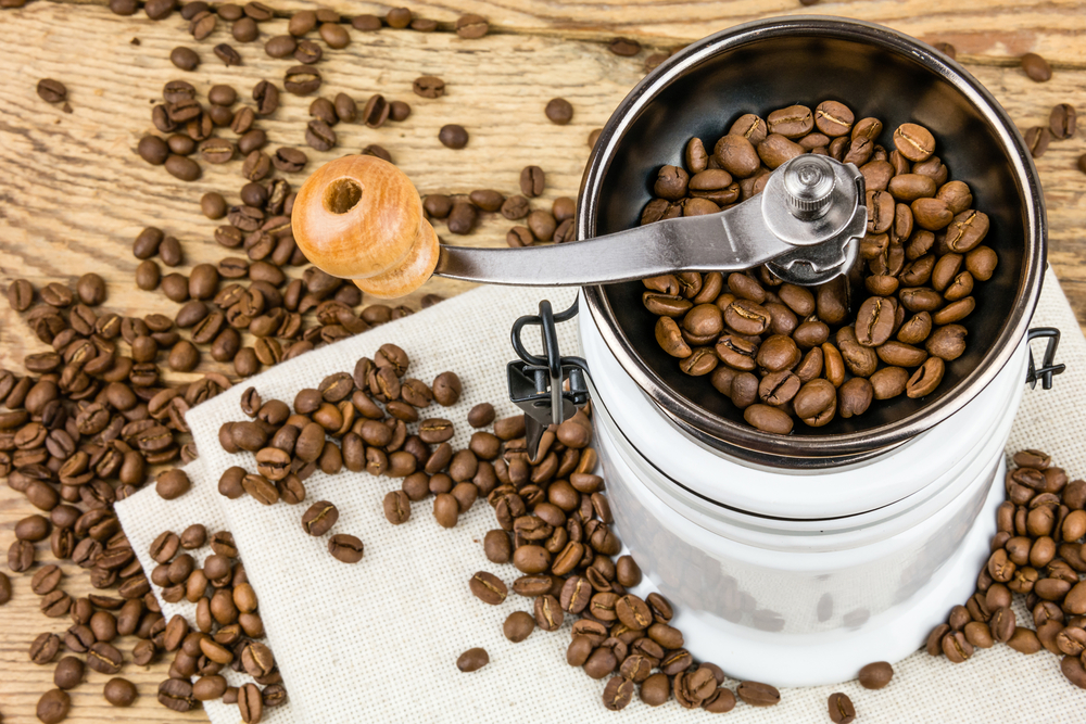coffee grinder with lots of coffee beans