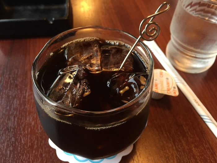 A glass of cold brew coffee on a table.