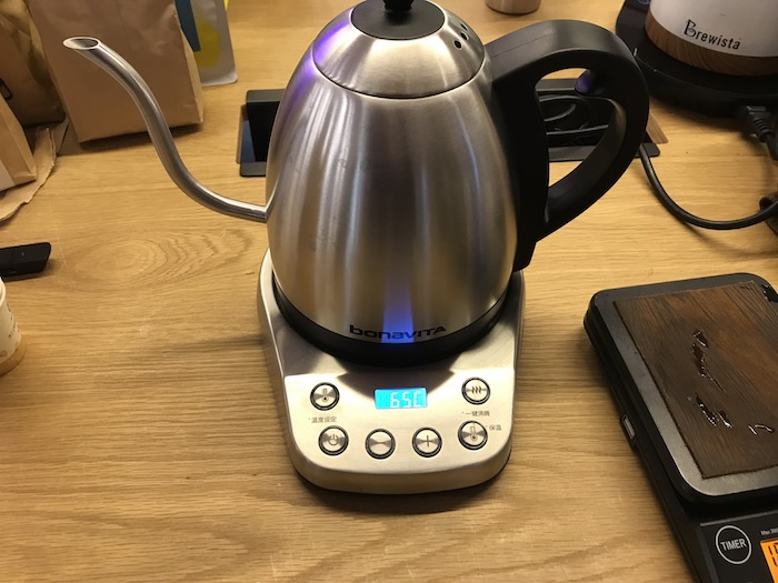 A coffee kettle on a table.