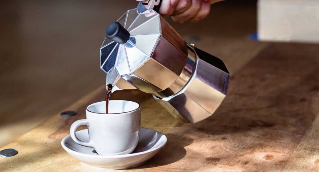 Coffee being poured from a coffee pot.