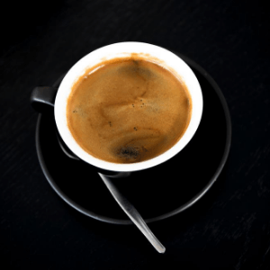 A cup of espresso coffee.