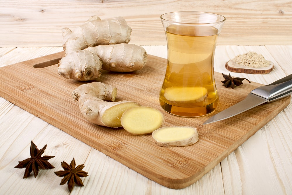 Ginger tea in a glass mug. One of the good teas for acid reflux.