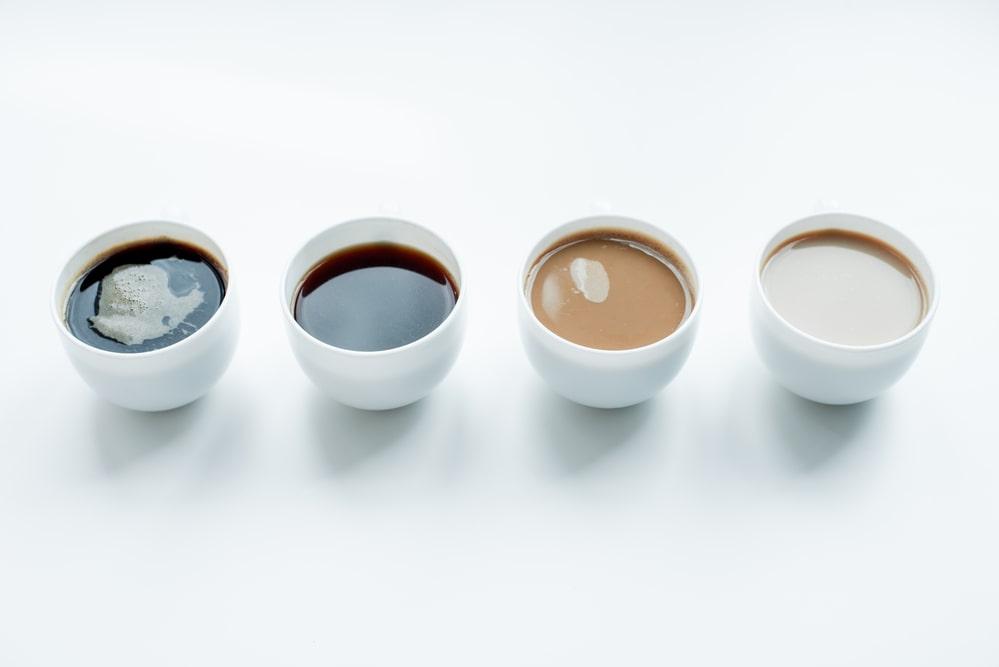 Multiple cups of americano coffee.