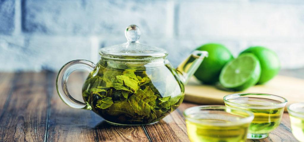Green tea brewed in a glass pot.