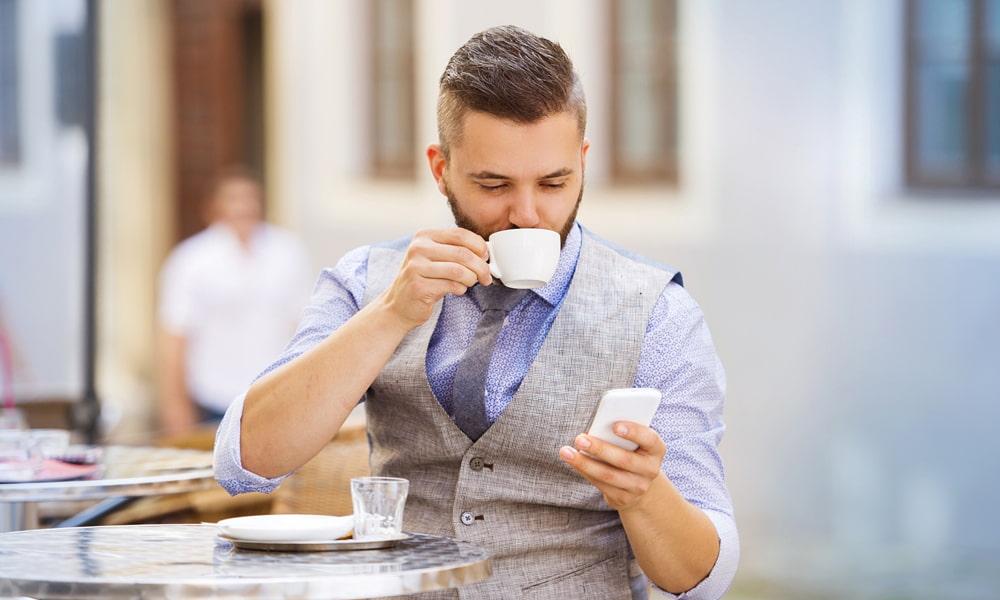 Man drinking espresso coffee.
