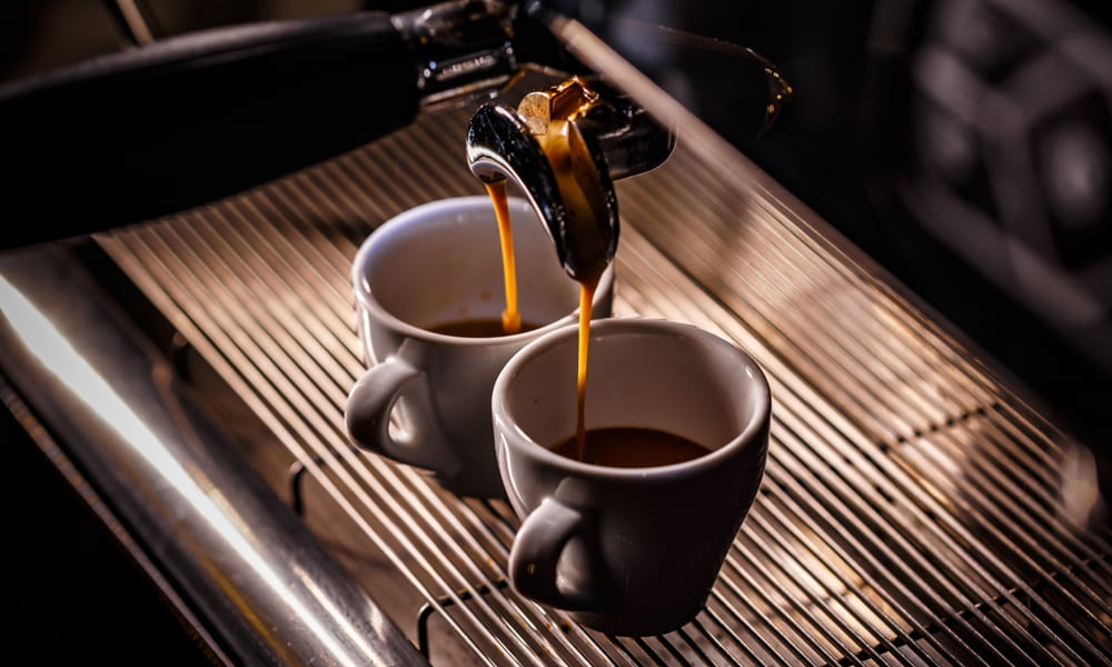 A cup of coffee on a table, with Espresso and Ristretto