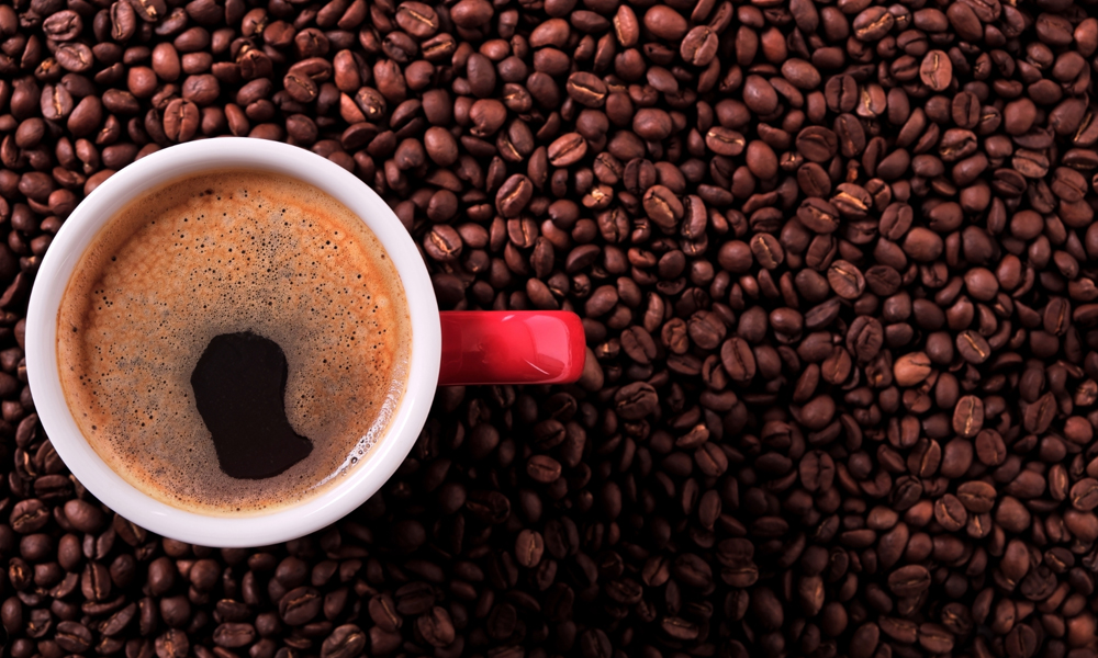 Freshly brewed coffee and roasted coffee beans.