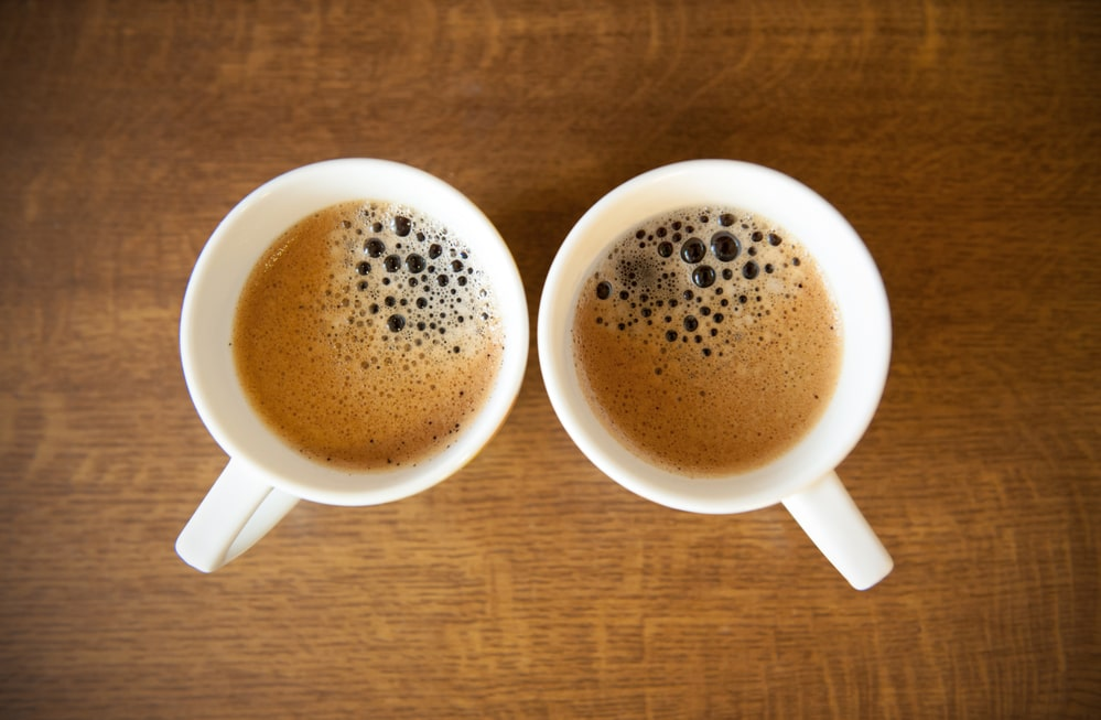 Two cups of espresso coffee on a table.
