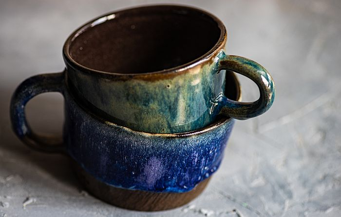 A close up of a coffee cup, with Mug and Pottery