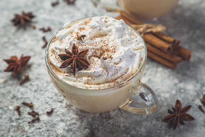 A cup of chai latte with whipped cream