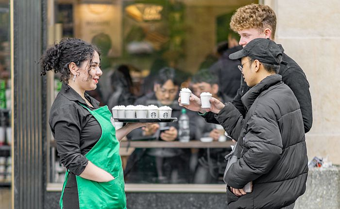 Starbucks crew with cups of their products