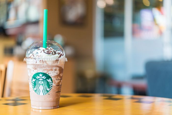 A cup of Frappuccino coffee on a table.