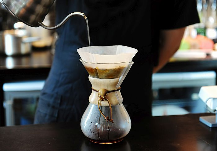 Brewing a regular cup of coffee using the pour-over method.