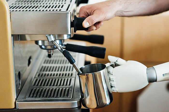 Espresso/Cappuccino Machine Wand Frothing a Coffee Creamer or Milk