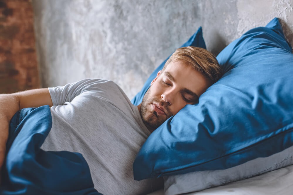 man sleeping softly in his bed