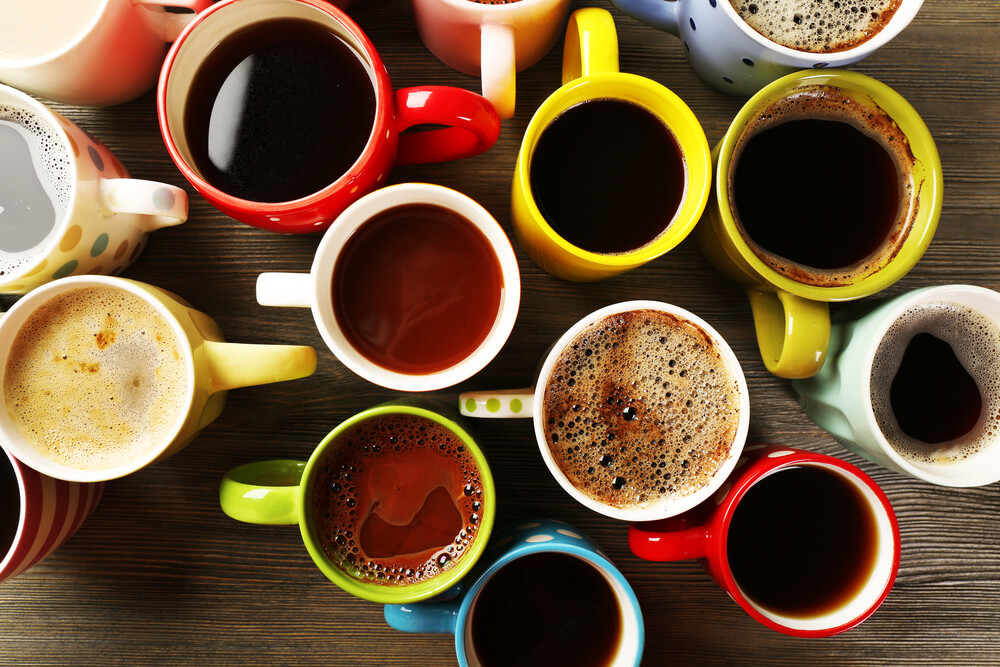 colorful mugs filled with varying types of coffee