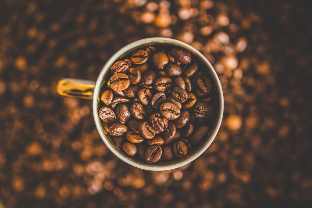 how many beans are in a cup of coffee - mug full of coffee beans