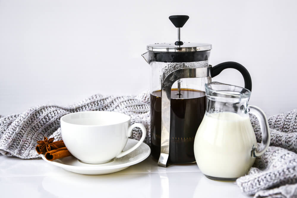 can you add milk directly to a French press - a jar of milk, French Press coffee, and a white coffee cup