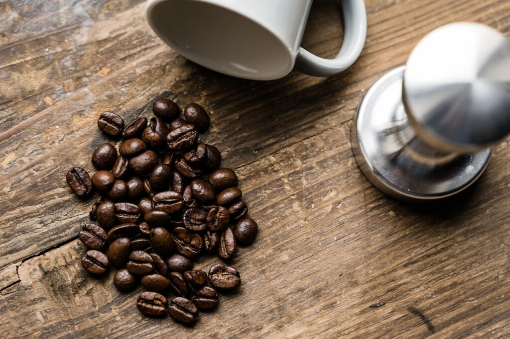 coffee beans laid on top of a flat wooden surface