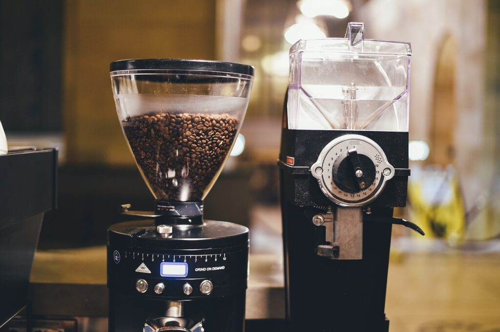 coffee grinder machine packed with coffee beans