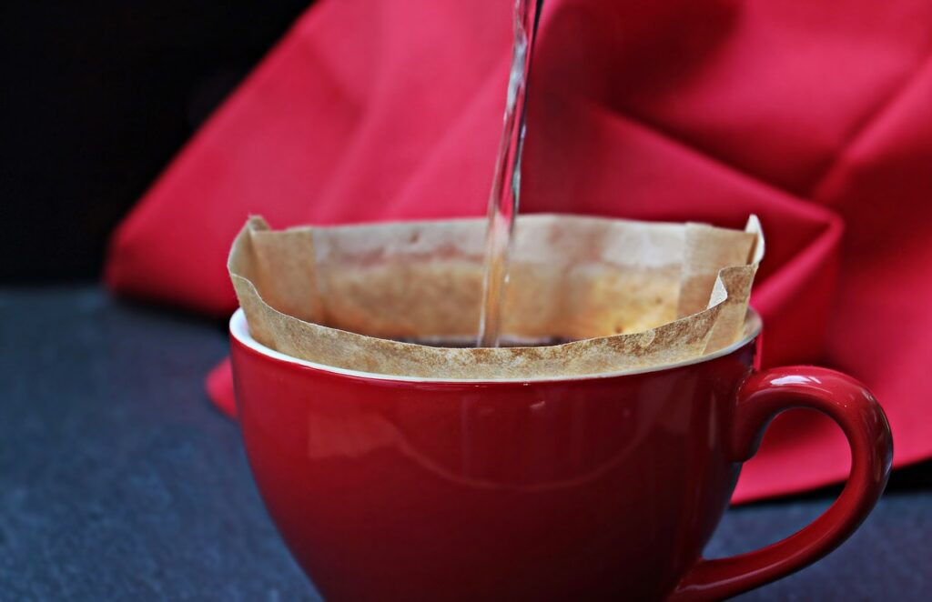 pouring water through a coffee filter