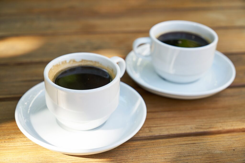 two black coffee in the top of a table