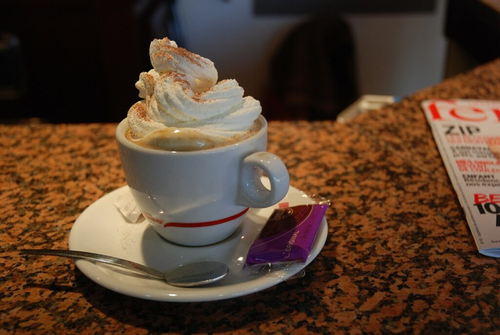 Can You Put Heavy Cream In Coffee - a large scope of cream on top of a coffee
