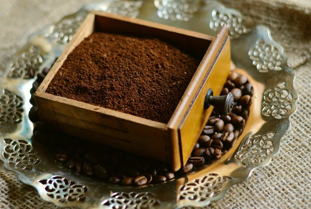 coffee grounds in a wooden box