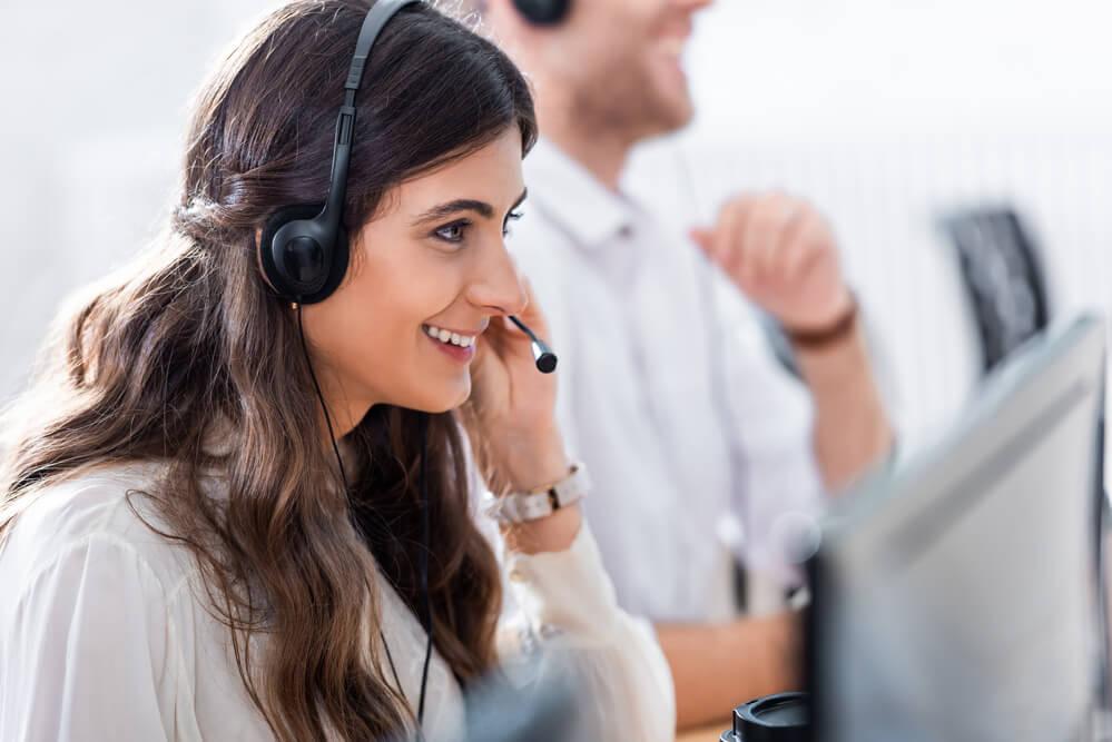 happy woman receiving customer's call