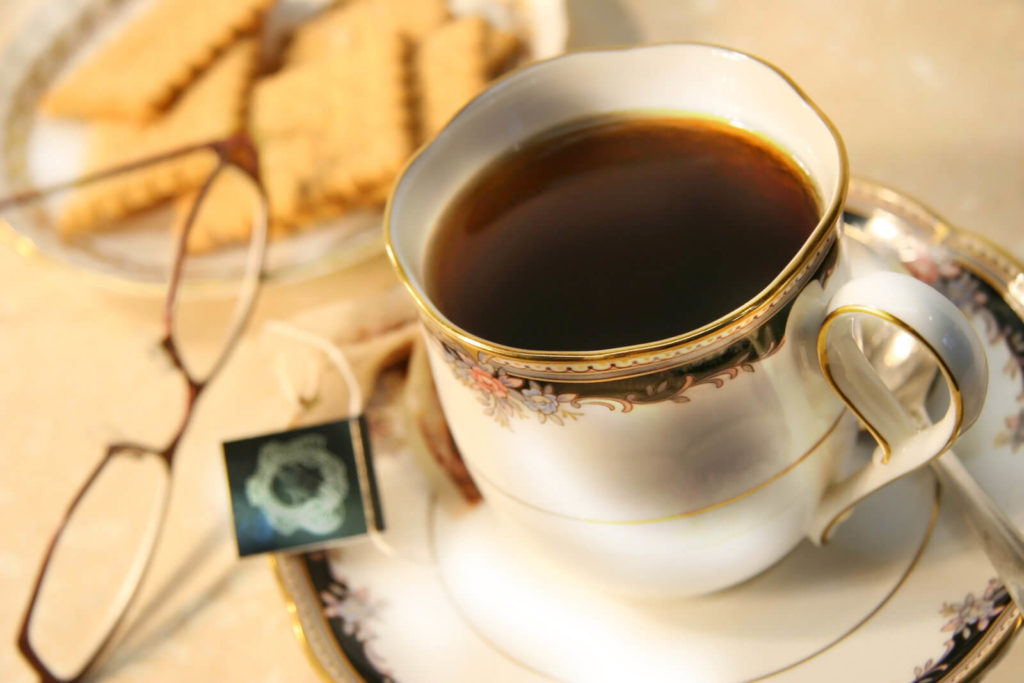 Cup of english breakfast tea with cookies for break time