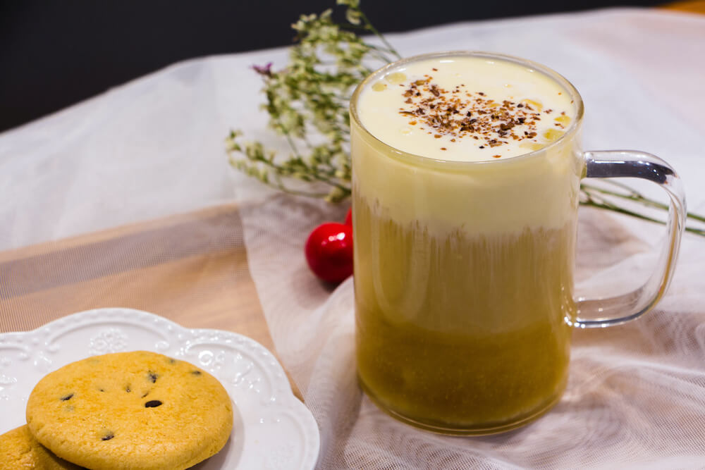 Jasmine green tea with milk in a clean glass - how to make jasmine milk tea