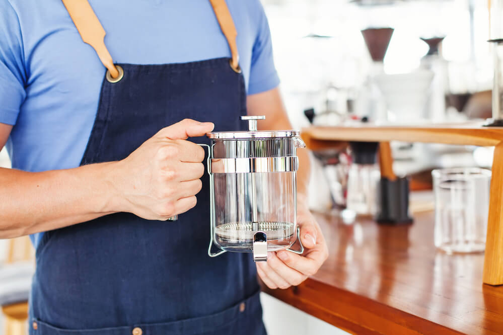 man holding a French Press