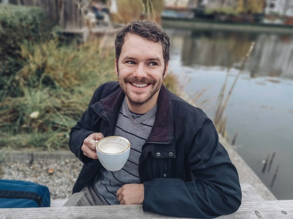happy man drinking his coffee outdoors