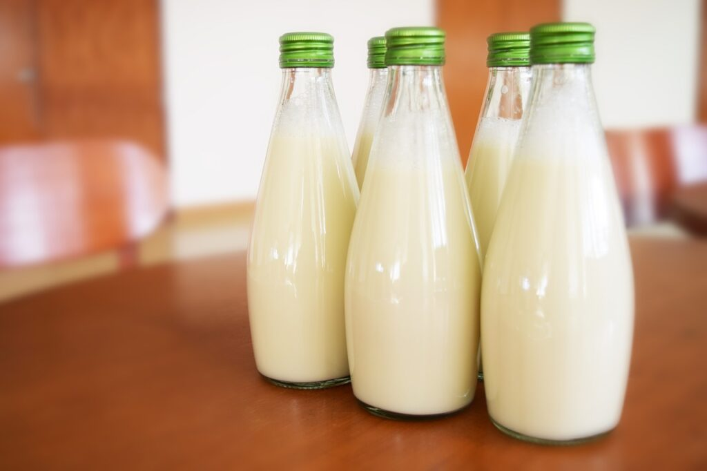bottles of milk at the top of a wooden table
