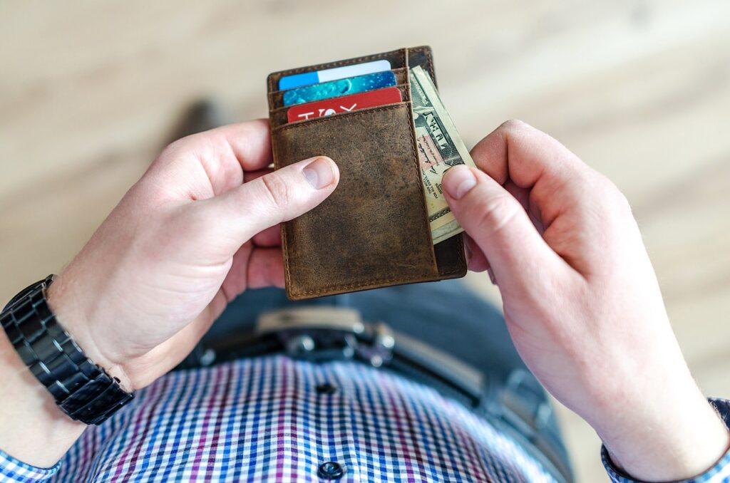 pulling out money from a leather wallet