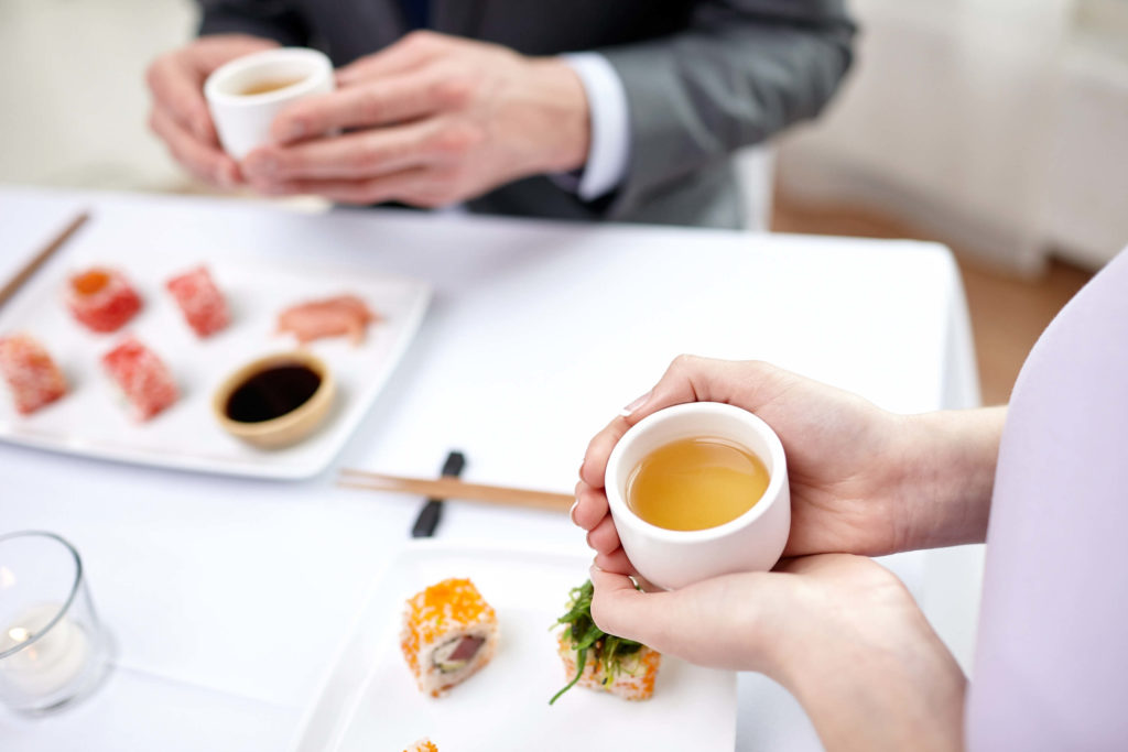 two people in tea room enjoying their cup of tea